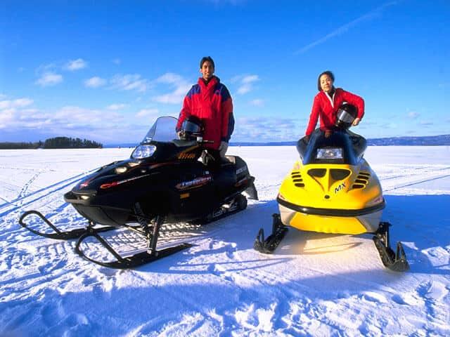 2 snowmobiles
